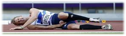 Athlete laying on side on track in pain from injury